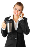Business woman with mobile phone and thermos. Smiling modern business woman with mobile phone and thermos isolated on white Royalty Free Stock Photo