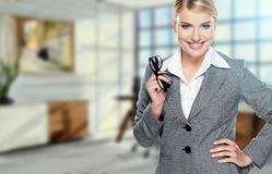 Business woman in modern glass interior Royalty Free Stock Photos