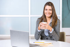 Business woman in modern office Stock Photos