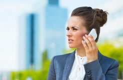 Business woman in modern office district talking smartphone Stock Image