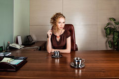 Business woman in modern office interior Royalty Free Stock Photography