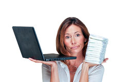 Business woman mom holds laptop and diapers Royalty Free Stock Image