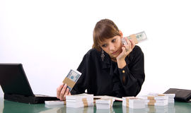 Business woman with money Royalty Free Stock Photos