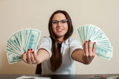 Business woman with money fans in hands Royalty Free Stock Photo