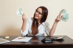 Business woman with money fans in hands Stock Image