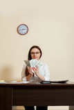 Business woman with money fans in hands Royalty Free Stock Images