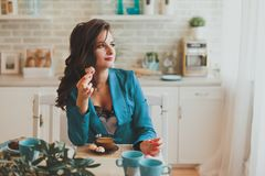 Business woman in the morning in the kitchen Royalty Free Stock Images