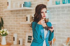 Business woman in the morning in the kitchen Royalty Free Stock Photography