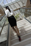 Business Woman Moving Up Staircase Stock Image