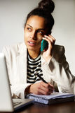 Business woman multi-tasking Stock Image