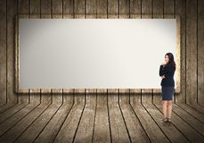 Business woman near billboard. Stock Image