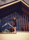 Business woman near building. Business woman standing in the background of glass building Stock Photo
