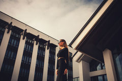 Business woman near building. Young business woman standing near the modern building Stock Images