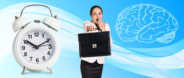 Business woman near classical alarm clock. On the blue abstract background royalty free stock image