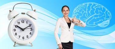 Business woman near classical alarm clock Stock Photos