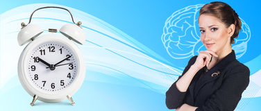 Business woman near classical alarm clock Royalty Free Stock Image