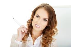 Business woman near flipchart. Stock Photo