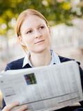 Business Woman with Newspaper Stock Photo
