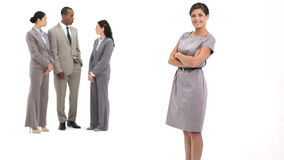 Business woman next to business team talking Royalty Free Stock Images