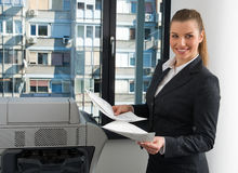 Business woman next to office printer Stock Photos