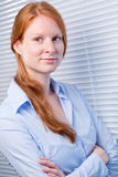 Business Woman Next to an Office Window royalty free stock photo