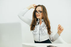 business woman with notebook in the office. Hands up of success emotions Royalty Free Stock Photography