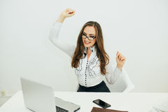 business woman with notebook in the office. Hands up of success emotions Royalty Free Stock Image
