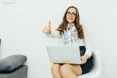 Business woman with notebook in the office. Okey gesture. Young pretty business woman with notebook in the office. Okey gesture Royalty Free Stock Photo