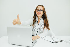 Business woman with notebook in the office with okey gesture. Young pretty business woman with notebook in the office with okey gesture Royalty Free Stock Photography