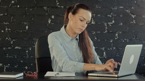 Business woman with notebook in the office. Professional shot on BMCC with high dynamic range. You can use it e.g in your commercial video, business or office stock video footage