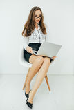 Business woman with notebook in the office sitting on chair. Royalty Free Stock Images