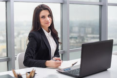 Business woman with notebook, office, workplace. Stock Photo