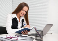 Business woman with notebook in the office Stock Photo