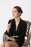 Business woman with a notebook and pencil Stock Photos