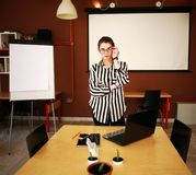 Business woman stand in office with white board presenting. Business woman with notebook stand in office with white board presenting in meeting room Stock Photos