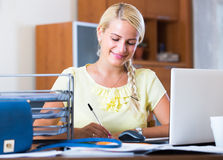 Business woman with notebook at work Royalty Free Stock Images