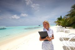 Business woman on ocean coast Stock Photo