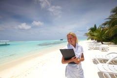 Business woman on ocean coast Stock Photo