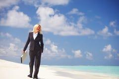 Business woman on the ocean coast Royalty Free Stock Photos