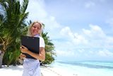 Business woman on ocean coast Royalty Free Stock Photography