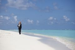 Business woman on the ocean coast Royalty Free Stock Photography