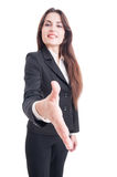 Business woman offering handshake with selective focus on hand Royalty Free Stock Photos