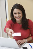 Business woman offering name tag  Stock Photo