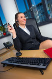 Business woman in office. Business woman with wireless headset at office desk Stock Image