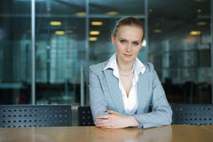 Business woman in the office. Sitting on a table alone Stock Photos