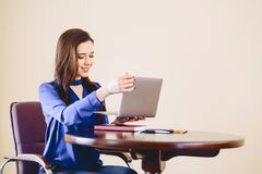 Business woman at office behind laptop. Working Stock Images