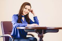 Business woman at office behind laptop. Working Stock Image
