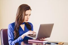Business woman at office behind laptop. Working Stock Photo