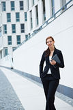 Business woman and office building Royalty Free Stock Image