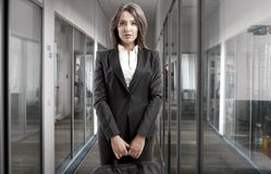 Business Woman. In office building interior holding her suitcase royalty free stock photo